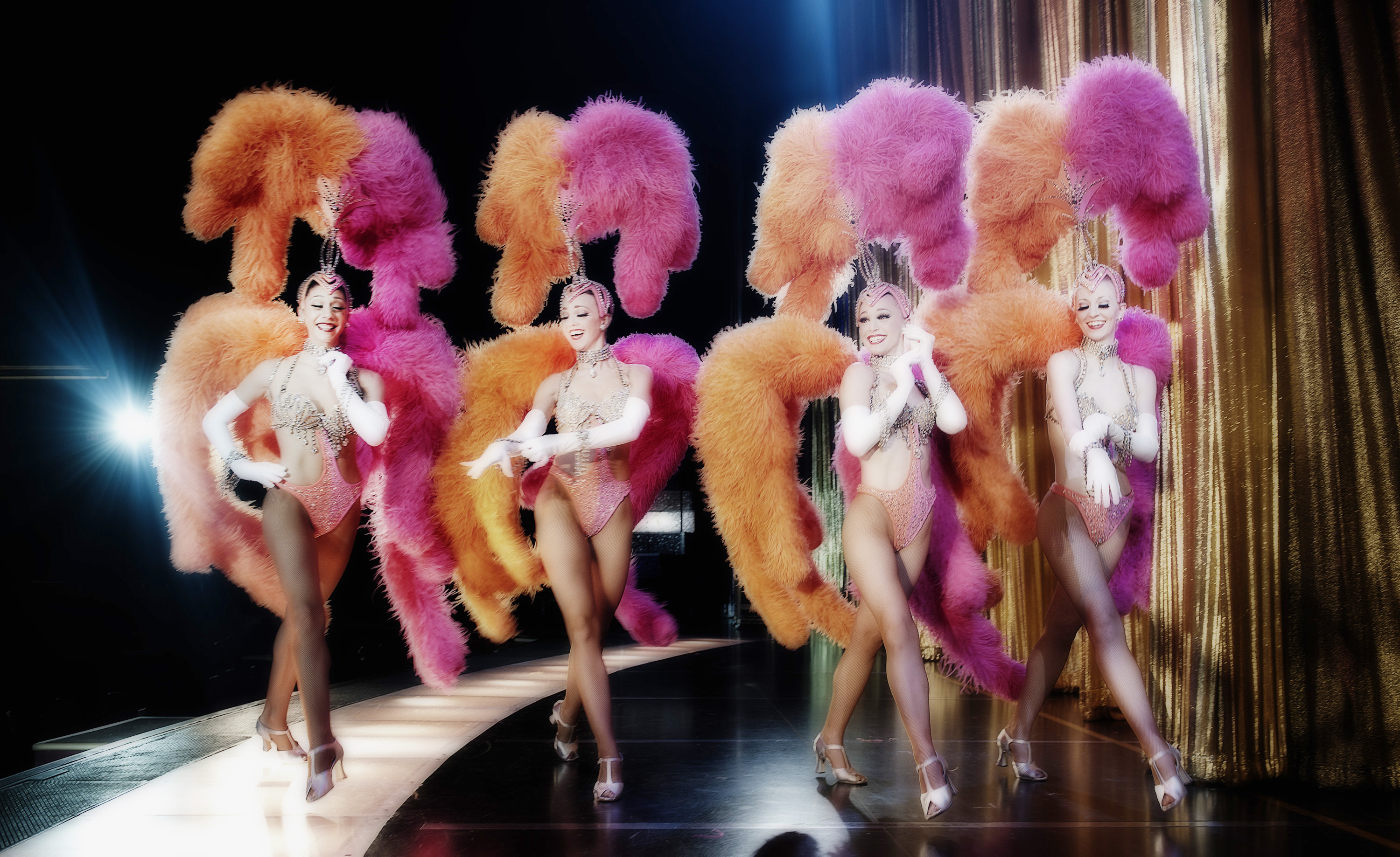 Feathered nude showgirls