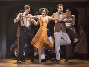 Caroline Bowman as Eva and the cast of the national tour of Evita.