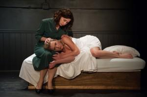 Rita's secretary (Katherine Swan) takes care of her damaged charge (Lee Stark).