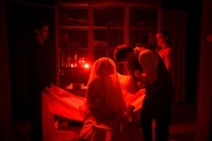 John Taflan, Megan Kohl, Michael Tepeli, and Amanda Drinkall in GREAT EXPECTATIONS at Strawdog Theatre.