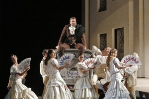 Lucas Meachem (Figaro) and the San Francisco Opera corps de ballet in SF Opera's production of THE BARBER OF SEVILLE.