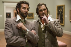 Bradley Cooper and Christian Bale in Columbia Pictures' AMERICAN HUSTLE