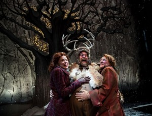 Mistress Ford (Heidi Kettenring), Sir John Falstaff (Scott Jaeck) and Mistress Page (Kelli Fox) meet in Windsor's woods for nighttime revels in Chicago Shakespeare Theater's production of The Merry Wives of Windsor, directed by Artistic Director Barbara Gaines.