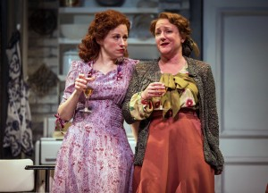 Best friends and confidantes, Mistress Ford (Heidi Kettenring) and Mistress Page (Kelli Fox) delight in their mischief in Chicago Shakespeare Theater's production of The Merry Wives of Windsor, directed by Artistic Director Barbara Gaines.