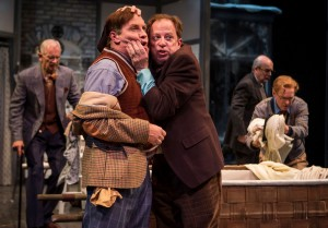 A jealousy-crazed Master Ford (Ross Lehman, right) clutches at the unsuspecting Master Page (Kevin Gudahl) in Chicago Shakespeare Theater's production of The Merry Wives of Windsor, directed by Artistic Director Barbara Gaines.