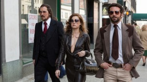 Christian Bale, Amy Adams and Bradley Cooper in Columbia Pictures' AMERICAN HUSTLE