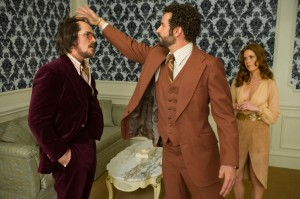 Christian Bale, Bradley Cooper and Amy Adams in Columbia Pictures' AMERICAN HUSTLE