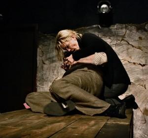 Eli Branson being held by Katherine Keberlein in Oracle's THE MOTHER. Photo by Eleanor Kahn.