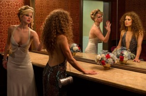 Jennifer Lawrence and Amy Adams in Columbia Pictures' AMERICAN HUSTLE