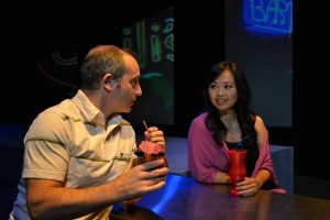 Jim Kane and Sandy Yu in 'Dallas Non-Stop,' a Playwrights' Arena production at Atwater Village Theatre.