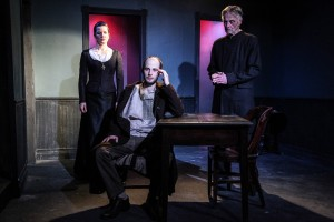 (left to right) Maureen Yasko, Ed Porter and Jack McCabe in Mary-Arrchie Theatre Co.'s production of CRIME AND PUNISHMENT, based on the novel by Fyodor Dostoyevsky, adapted by Marilyn Campbell and Curt Columbus and directed by Artistic Director Richard Cotovsky. Photo by Emily Schwartz.