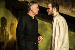 (left to right) Jack McCabe and Ed Porter in Mary-Arrchie Theatre Co.'s production of CRIME AND PUNISHMENT, based on the novel by Fyodor Dostoyevsky, adapted by Marilyn Campbell and Curt Columbus and directed by Artistic Director Richard Cotovsky. Photo by Emily Schwartz.