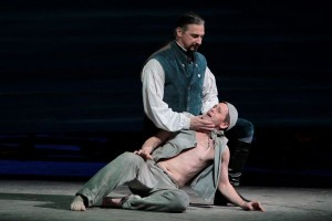 Greer Grimsley as John Claggart (top) with Keith Jameson as the Novice in LA Opera's BILLY BUDD.