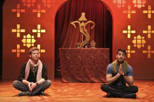 Keshav Kurundkar played by Christian Durso and Naveen Gavaskar played by Andy Gala pray to Hindu deity Ganesh in East West Players' A NICE INDIAN BOY.