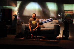 Chuck (Jerry MacKinnon) reaches a pivotal moment in a video game in Steppenwolf for Young Adults' production of Leveling Up by Deborah Zoe Laufer, directed by Hallie Gordon.