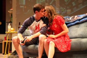 Zander (JJ Phillips) and Jeannie (Carolyn Braver) steal a kiss in Steppenwolf for Young Adults' production of Leveling Up by Deborah Zoe Laufer, directed by Hallie Gordon.