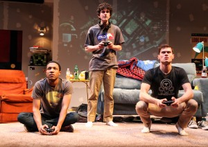 Chuck (Jerry MacKinnon), Ian (Clancy McCartney) and Zander (JJ Phillips) play a game together in Steppenwolf for Young Adults' production of Leveling Up by Deborah Zoe Laufer, directed by Hallie Gordon.