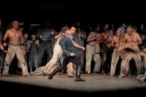 Liam Bonner as Billy Budd and Matthew O'Neill (holding knife) as Squeak in LA Opera's BILLY BUDD.