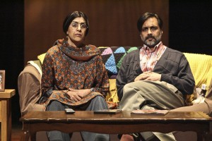 Parents Megha and Archit Gavaskar, played by Rachna Khatau and Anjul Nigam, watching the film MILK in hopes to learn more about their gay son in the comedy A NICE INDIAN BOY  at East West Players.
