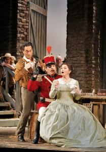 Tenor Giuseppe Filianoti (Nemorino), baritone Malcolm Mackenzie (Belcore) and soprano Tatiana Lisnic (Adina) in San Diego Opera's THE ELIXIR OF LOVE.