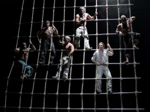 The crew of the HMS Indomitable in LA Opera's BILLY BUDD. Liam Bonner as Billy is at lower right.