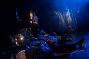 Lea Pascal as the Ferrywoman navigates the River Styx  with a ghostly ensemble in Buzz22 Chicago's Professional World Premiere of Ghost Bike by  Laura Jacqmin, directed by Company Member Sara Sawicki.