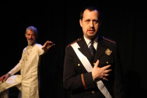Jeff Paul as POLIXENES (background) and Ethan Cadoff as LEONTES in WorkShop Theatre's THE WINTER'S TALE.