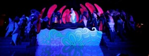 Matthew O'Neill (center) as Jonah, surrounded by sea creatures in the belly of the whale from LA Opera's JONAH AND THE WHALE.