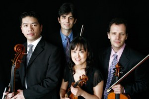The Avalon String Quartet - Cheng-Hou Lee, cello, Blaise Magniere, violin, Marie Wang, violin (front center), and Anthony Devroye, viola.