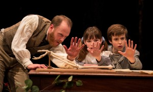 Andrew White, Caroline Heffernan, and John Francis Babbo in Lookingglass's production of IN THE GARDEN, A DARWINIAN LOVE STORY.