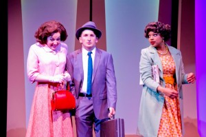 Elizabeth Telford as Rosemary, Tyler Ravelson as J. Pierrepont Finch and Sharriese Hamilton as Smitty in Porchlight Music Theatre's How to Succeed in Business Without Really Trying.