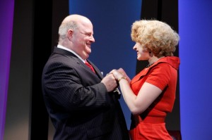 Fred Zimmerman as Mr. Biggley and Emily Ariel Rogers as Hedy La Rue IN Porchlight Music Theatre's How to Succeed in Business Without Really Trying.