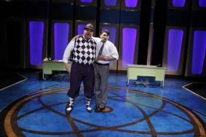 Fred Zimmerman as Mr. Biggley and Tyler Ravelson as J. Pierrepont Finch in Porchlight Music Theatre's How to Succeed in Business Without Really Trying.