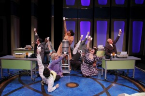 Sharriese Hamilton as Smitty and the cast perform 'Coffee Break' in Porchlight Music Theatre's How to Succeed in Business Without Really Trying.