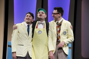 Tyler Ravelson as J. Pierrepont Finch, Matthias Austin as Twimble and John Keating as Bud Frump in Porchlight's HOW TO SUCCEED IN BUSINESS WITHOUT REALLY TRYING.