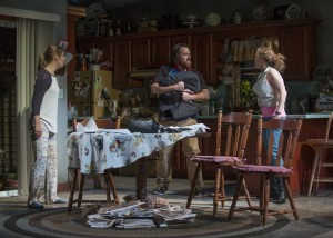 Zoe Perry (Manda), Ira Amyx (The Pizza Guy), and Caroline Neff (Meesh) in Steppenwolf's production of THE WAY WEST.