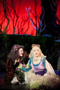 Betts Malone as The Witch beckons Rapunzel (Christanna Rowader) in 3-D Theatricals' INTO THE WOODS.