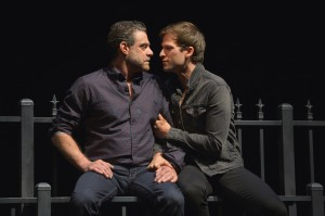 (l to r) At Berkeley Rep, Lou Liberatore (Pill) and Jordan Geiger (Eli) portray lovers in the West Coast premiere of Tony Kushner's The Intelligent Homosexual's Guide to Capitalism and Socialism with a Key to the Scriptures, an epic family drama.