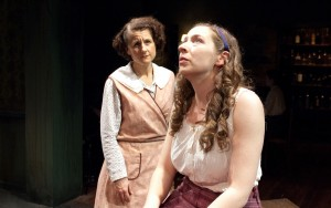 Juno Boyle (Marya Grandy, left) listens as her daughter Mary (Emily Glick) sings about her many grand wishes in TimeLine Theatre's Chicago premiere production of the musical JUNO, book by Joseph Stein, music and lyrics by Marc Blitzstein, based on the play Juno and the Paycock by Sean O'Casey, directed by Nick Bowling with music direction by Doug Peck and Elizabeth Doran, presented at TimeLine Theatre, 615 W. Wellington Ave., Chicago, April 23 - July 27, 2014.