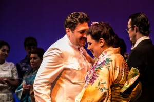 Dylan F. Thomas (Pinkerton, director of production), Marina Harris (Butterfly), and company in Center Stage Opera's MADAMA BUTTERFLY.
