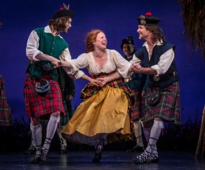 Jamy Meek (Ensemble), Maggie Portman (Meg Brockie) and Richard Strimer (Ensemble) in BRIGADOON at the Goodman Theatre.