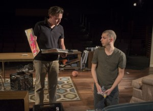 (left to right) Dennis (Kieran Culkin) and Warren (Michael Cera) look through Warren's record collection in Steppenwolf Theatre Company's production of This Is Our Youth by Kenneth Lonergan.
