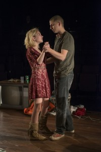 (left to right) Jessica (Tavi Gevinson) and Warren (Michael Cera) share a slow dance in Steppenwolf Theatre Company's production of This Is Our Youth by Kenneth Lonergan.