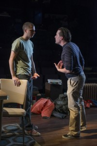 Warren (Michael Cera) and Dennis (Kieran Culkin) have an argument in Steppenwolf Theatre Company's production of This Is Our Youth by Kenneth Lonergan.