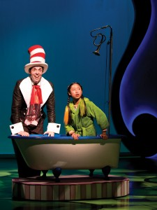 "The Cat in the Hat (Alex Goodrich) shows JoJo (Emily Chang) that, through the power of her imagination, anything can happen in the song ""It's Possible"" in Chicago Shakespeare Theater's Seussical, directed by Scott Weinstein"