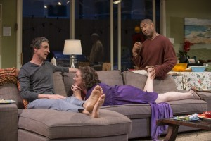 Old friends (left to right) Roger (David Pasquesi), Deb (Kirsten Fitzgerald) and Ken (Paul Oakley Stovall) catch up with one another in THE QUALMS at Steppenwolf.