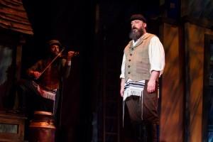 Alex Honzen (Tevye) and Ryan Naimy (Fiddler) in Light Opera Works' FIDDLER ON THE ROOF.