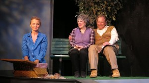 Alexis (Celia Schaefer) imagines picknicking with her parents (Gillien Goll and Bob Ari) in VOICES OF SWORDS.