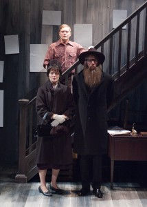 Asher Lev (Alex Weisman, center) doesn't know how his parents (Danica Monroe and Lawrence Grimm) will respond to his paintings in TimeLine Theatre's Chicago premiere of My Name is Asher Lev by Aaron Posner, adapted from the novel by Chaim Potok, directed by Kimberly Senior, presented at Stage 773, 1225 W. Belmont Ave., Chicago, August 22 - October 18, 2014. Photo by Lara Goetsch.
