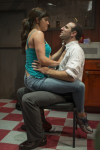 Sarah Loveland and Eric Burgher in Profile Theatre's production of Neil LaBute's REASONS TO BE HAPPY.